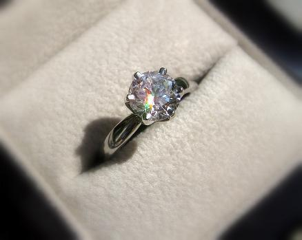 I will probably put a shared prong moissanite band with it in the near